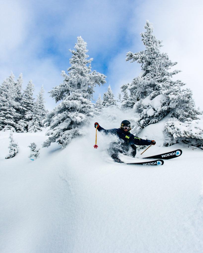 Skiing through glades of powder, Whistler.