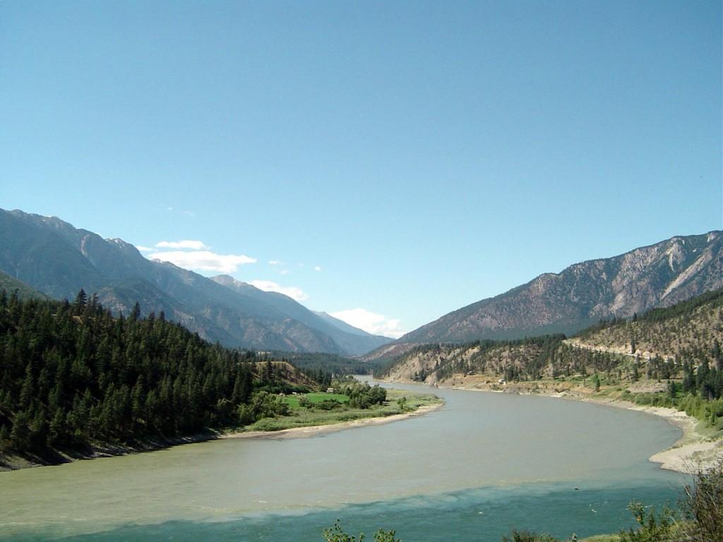 A river winds through a mountainous landscape.
