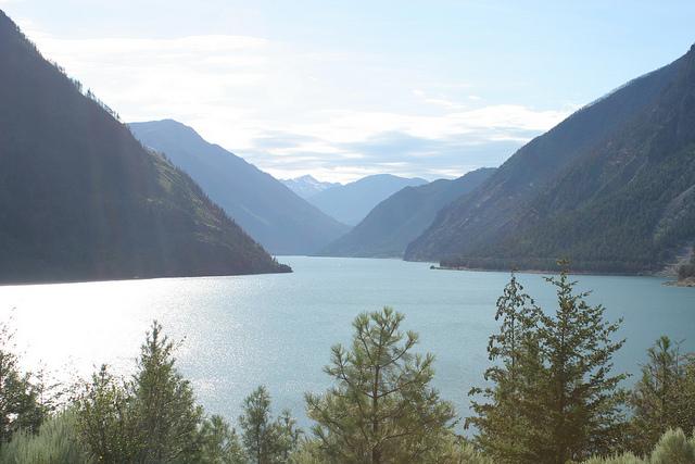 A massive lake nestled between mountain ranges.