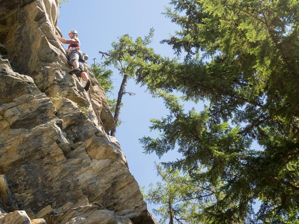 A rock climber scales a small mountain.