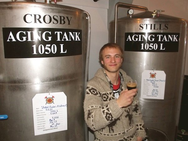 Firehall Brewery's Sid Ruhland with some musically themed tanks in his brewery.