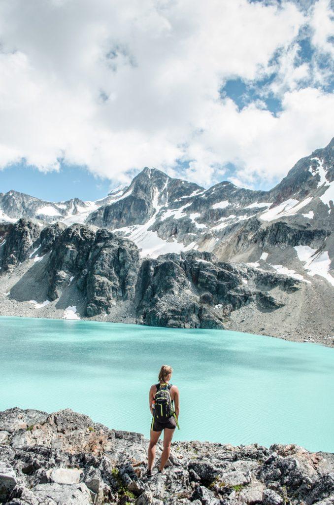 Hiker enjoying the view of Wedgemount Lake, Whistler