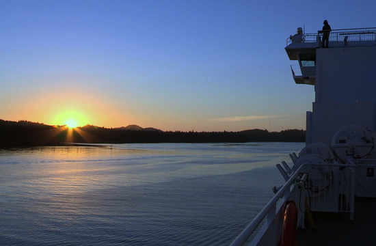 The sun sets over a BC Ferry.