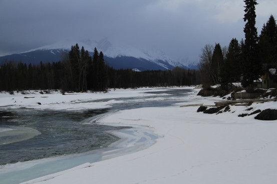 A winding river in a snow-covered landscape.