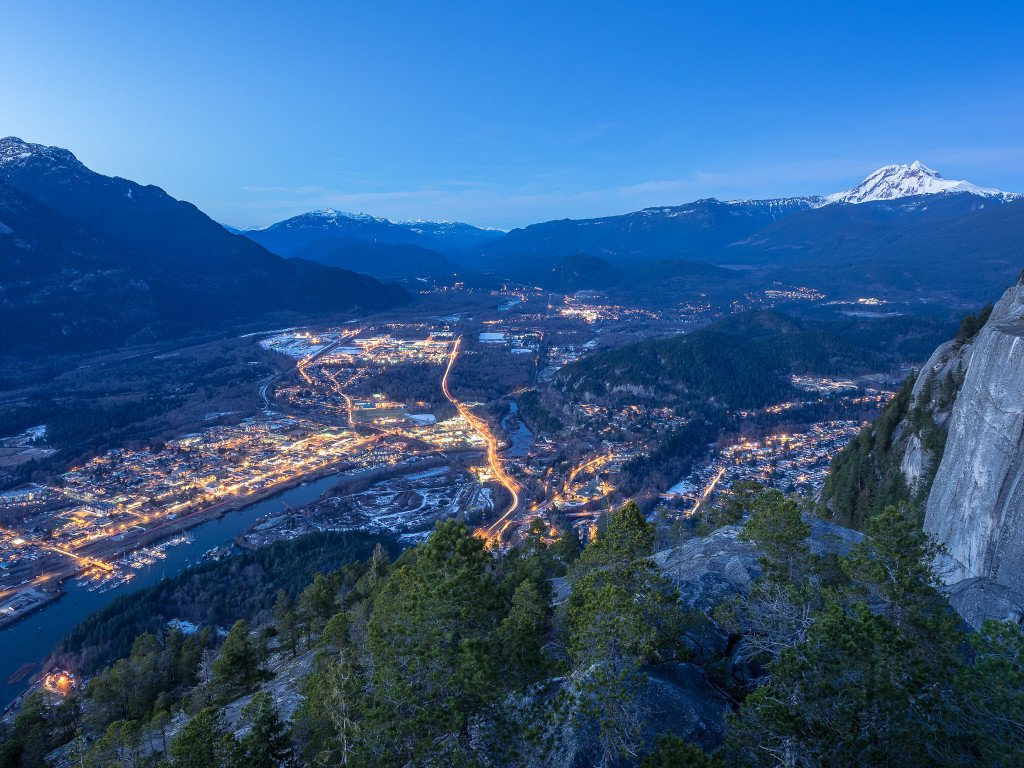 A twilight view of the town of Squamish from the top of the Stawamus Chief.