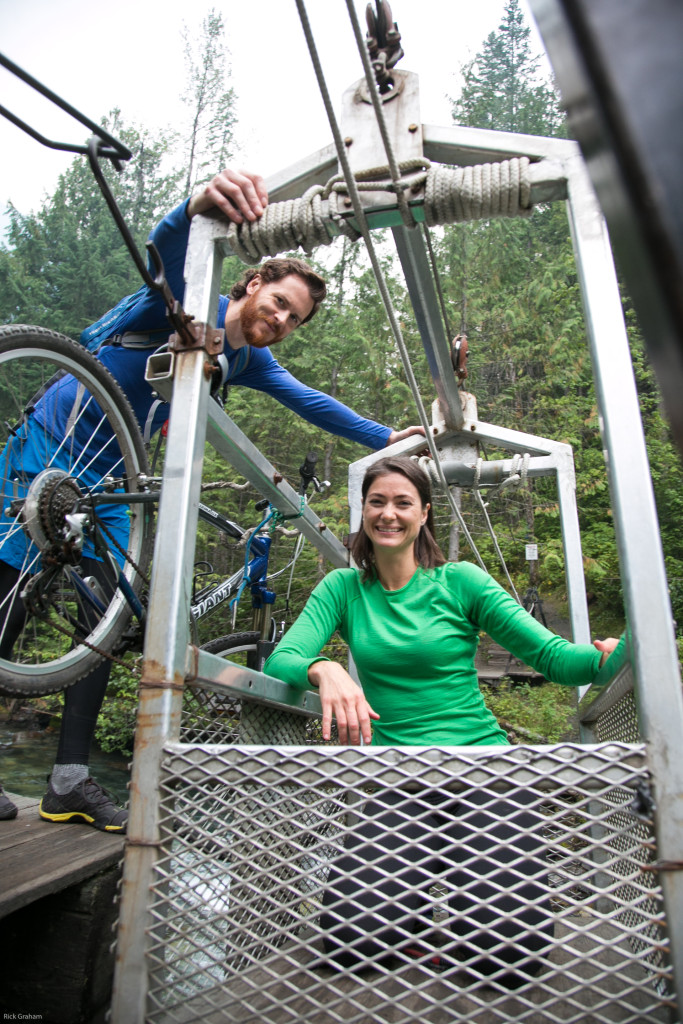 A man and woman explore the wilderness by bicycle.