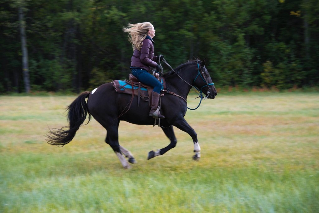 Tiffany on horseback in the Chilcotin grasslands. Photo: Geoff Moore