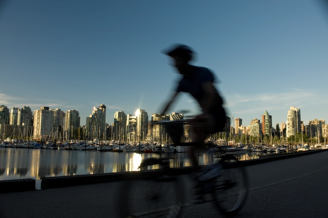 Silhouette of a cyclist against the Vancouver skyline.