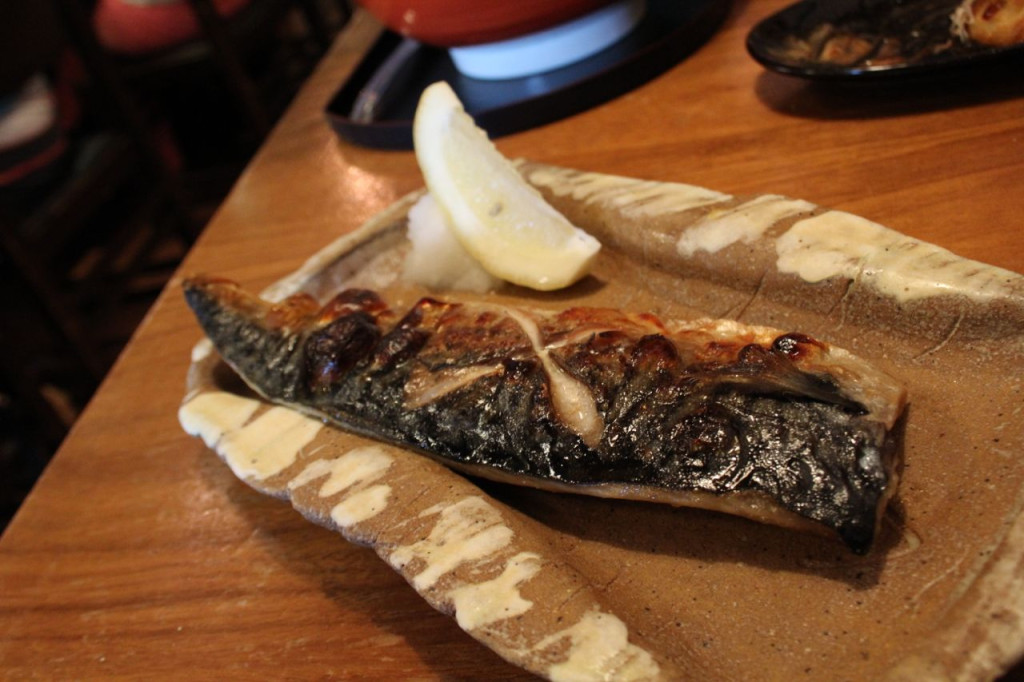 A beautifully plated dish of grilled Mackerel.
