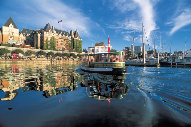A Harbour Ferry in front of the Fairmont Empress at Victoria's Inner Harbour.