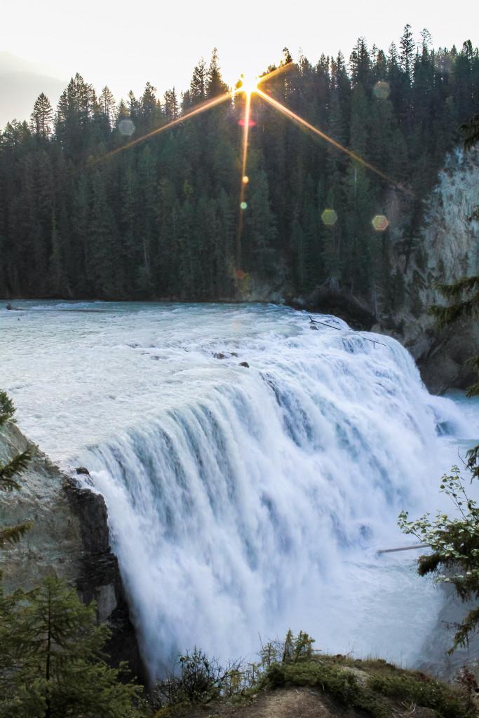 A cascading waterfall in a rocky landscape.