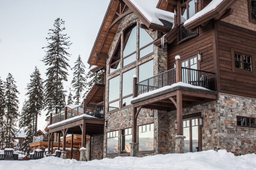 A stunning ski lodge in Revelstoke under a clear sky.