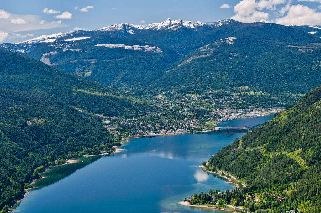 Aerial view of Kootenay Lake, nestled in a mountainous landscape.