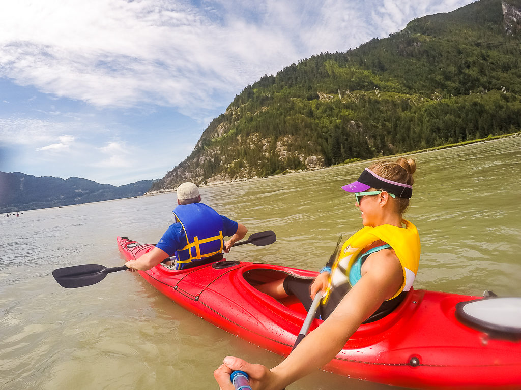 Kayakers reaching the end of the Squamish River and entering the Howe Sound.