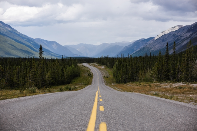 The Alaska highway through Muncho Lake Provincial Park.