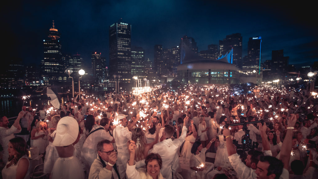 Le Diner en Blanc diners at Vancouver's Canada Place.