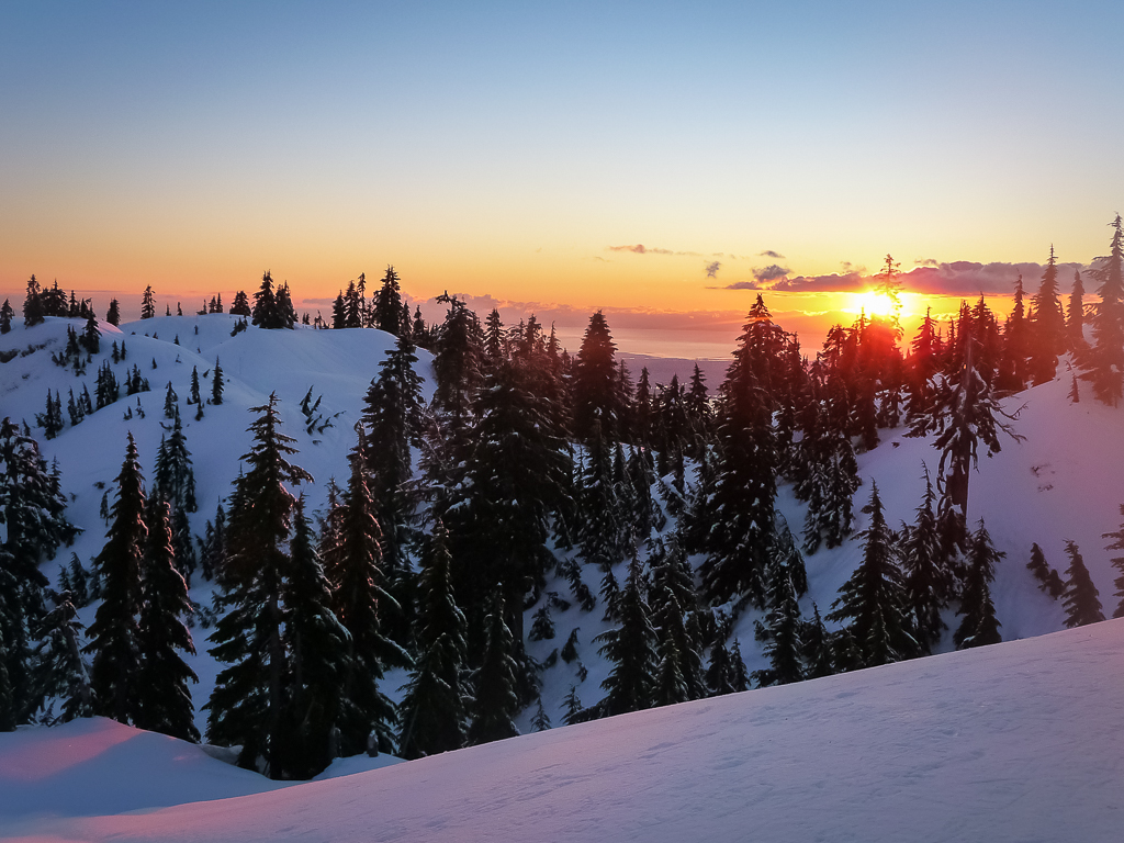 A gorgeous sunset on Mount Seymour filling the sky with orange blue and purple hues.