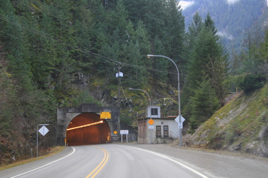 The highway continues into a tunnel through a mountain.