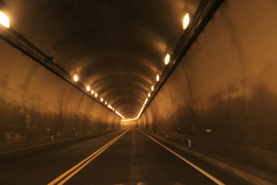 Driving through a dimly lit tunnel.
