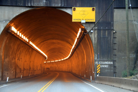 "Entrance to a highway tunnel with a sign that reads ""Alexandra Tunnel""."