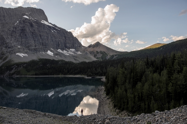 A hiker on a moraine above Floe Lake in Kootenay National Park. Photo: Kari Medig