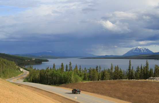 Car driving into Atlin, in Northern British Columbia.