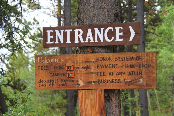 Entrance sign at Pine Creek Campground in Atlin, BC.