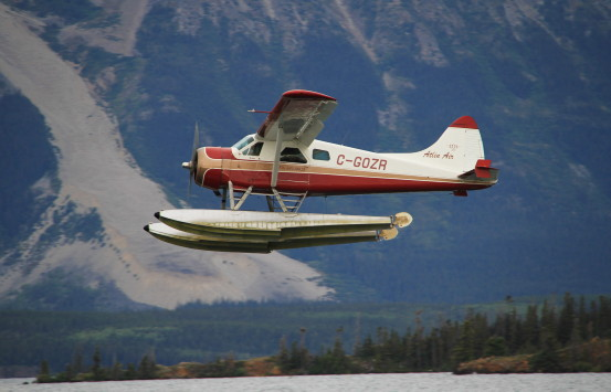 Float plane flying into Atlin, in Northern BC.