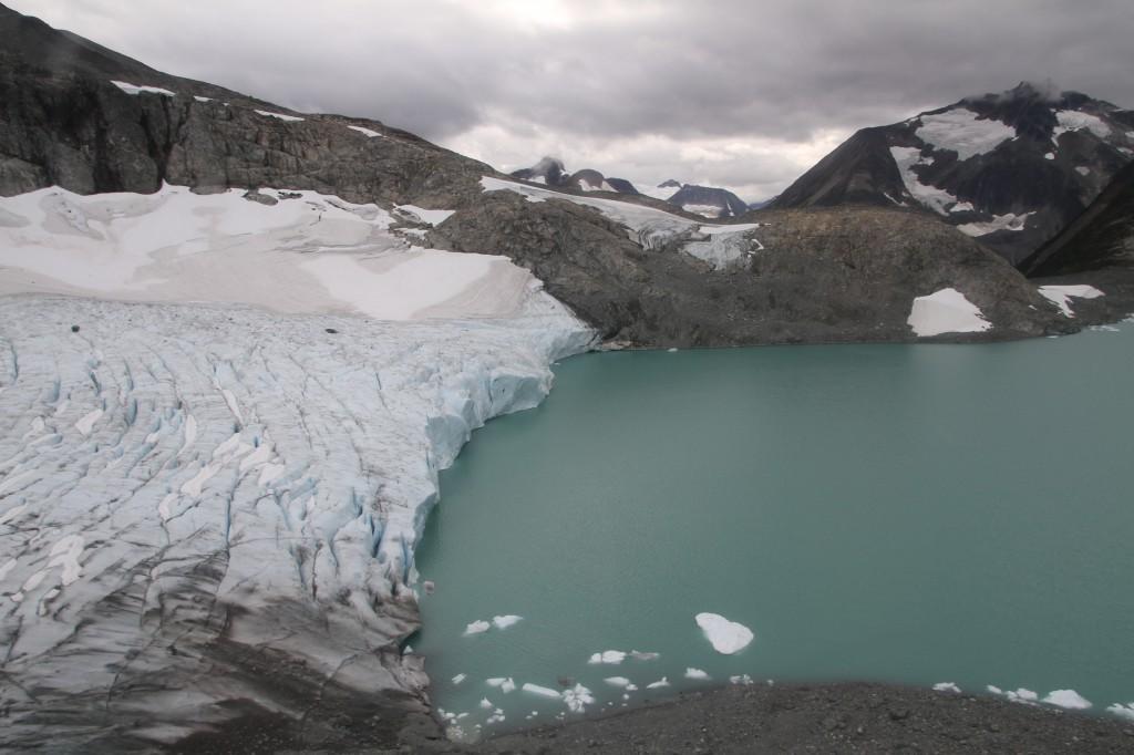 A glacier valley under a cloudy sky.