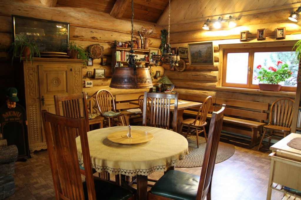 Interior of a log cabin's cozy dining room.