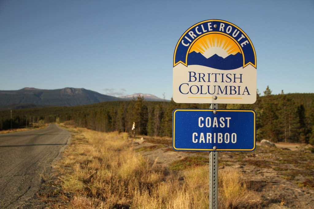 "A sign next to a highway that reads British Columbia Circle Route Coast Cariboo""."