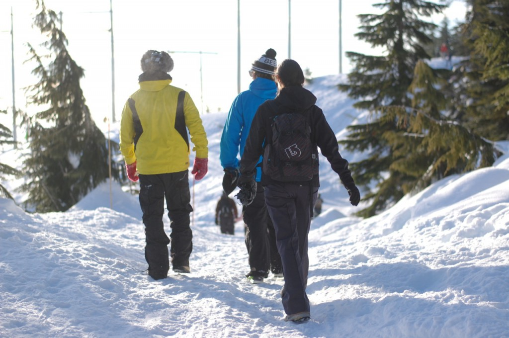 Three people walking in the snow