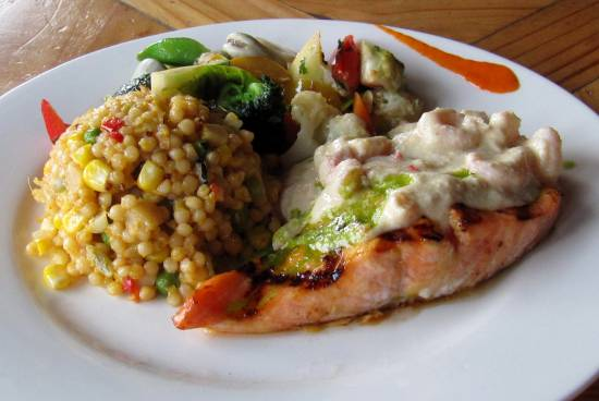 A white plate with salmon, grains and an array of colourful vegetables at Soule Creek Lodge.