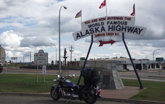 Motorcycle at Mile 0 of the Alaska Highway