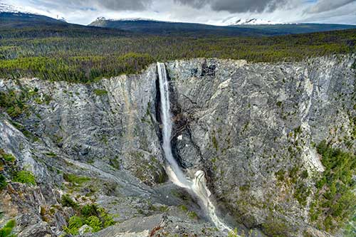 A forested plateau with a large waterfall
