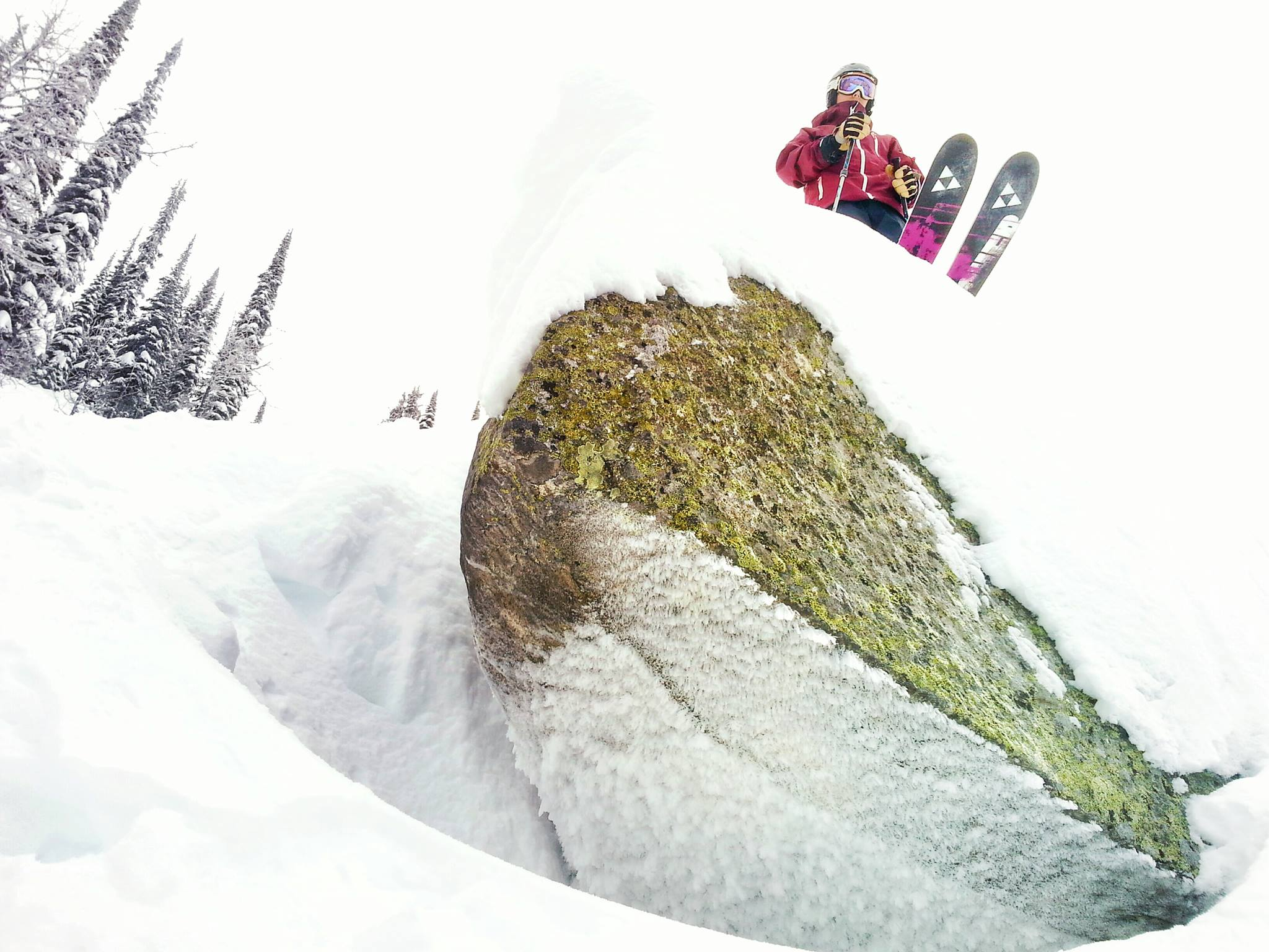 Skier scopes out the landing on a terrain feature at Whitewater Ski Resort in Nelson. Photo: Gina Bégin