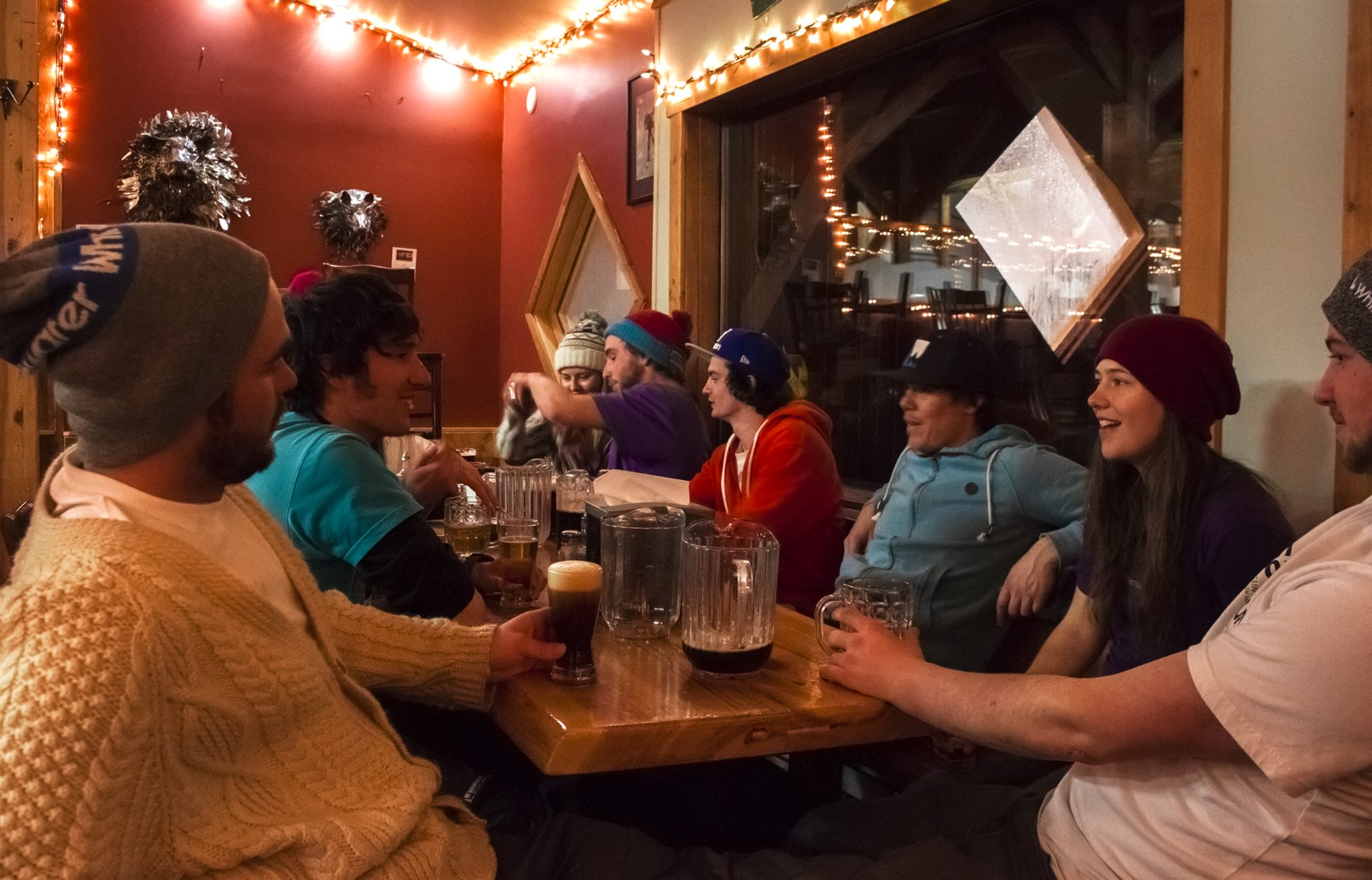 """Whitewater ski instructors hang out after work at Whitewater Ski Resort's """"Coal Oil Johnny's"""" in Nelson. Photo: Gina Bégin"""