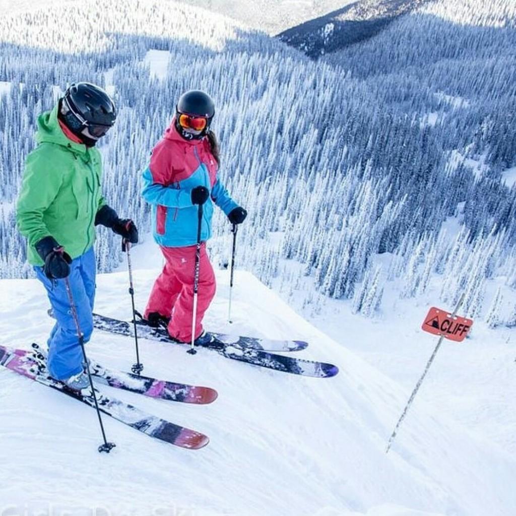 Friends talk each other into skiing a line at Revelstoke Mountain Resort. Photo: Agathe Bernard
