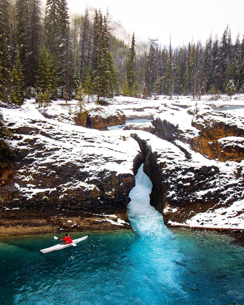 Kayaking by Natural Bridge in Yoho National Park in Field, BC