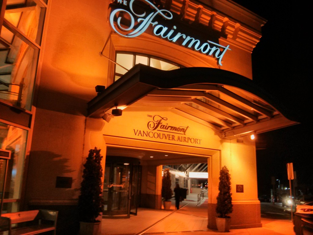Exterior of the Fairmont Vancouver Airport Hotel at night.