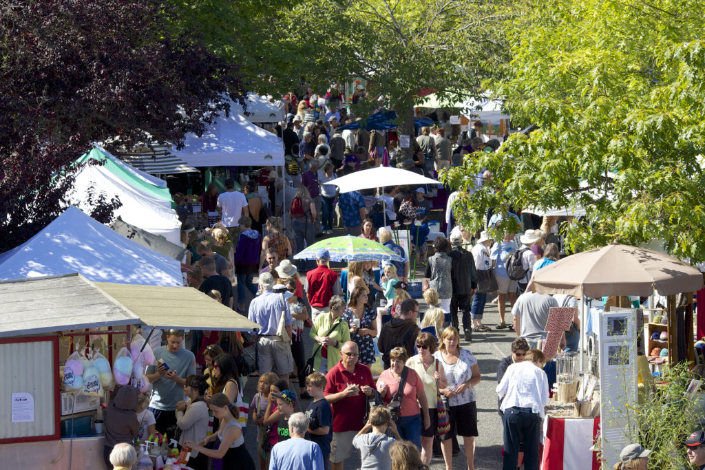 A busy outdoor market on a sunny day.