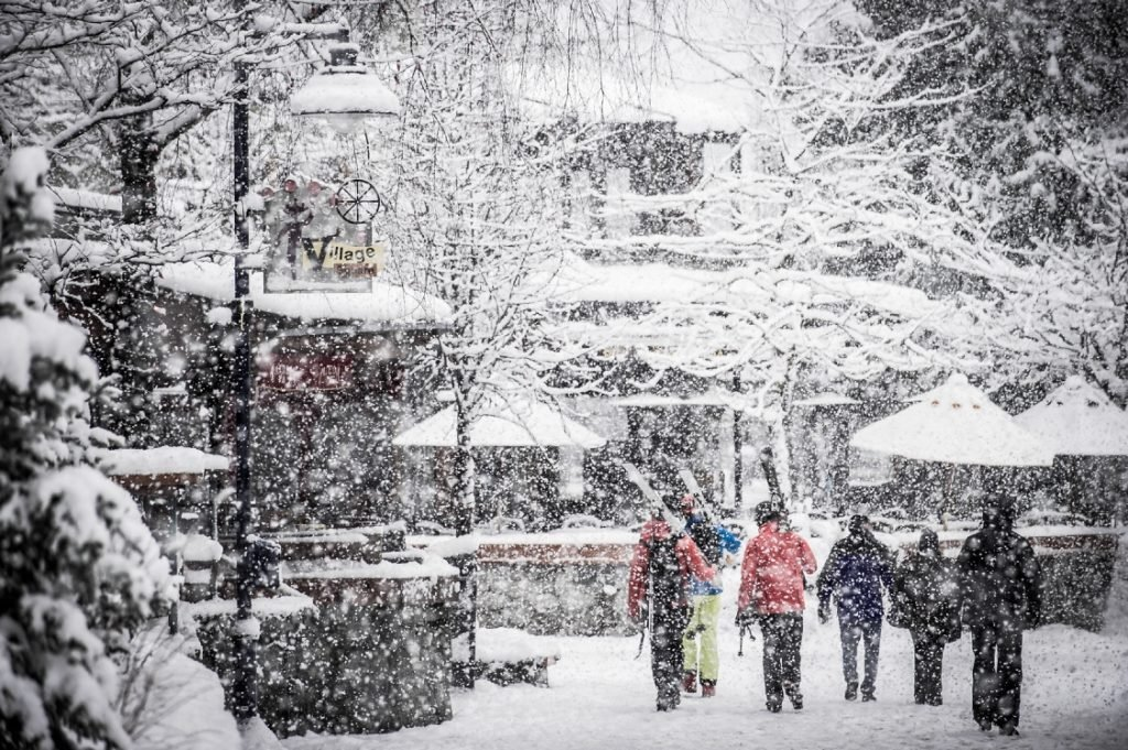 Strolling through Whistler Village on a snowy day.